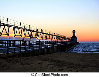Lighthouse at Sunset - St. Joseph North Pier Lighthouse in...
