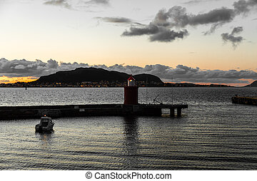 Lighthouse at the inlet to ?lesund at sunset, Norway