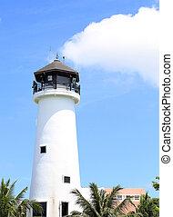 lighthouse at the marina against blue sky