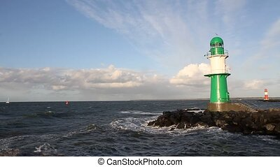 Lighthouse at Warnemuende, near Rostock - Germany. Stormy...