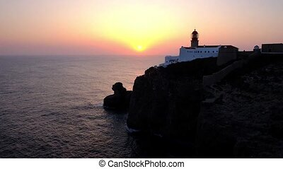 Lighthouse Cabo Vicente in Sagres Portugal at sunset