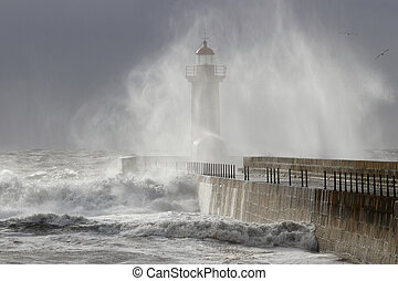 Lighthouse covered by waves spray