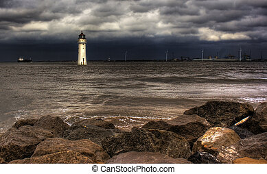 Lighthouse hdr - Lighthouse against a stormy sky HDR