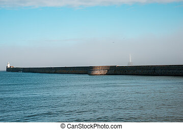 Lighthouse hiding in a haze in Aberdeen Harbour entrance