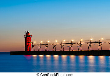 Image of a lighthouse at sunset.