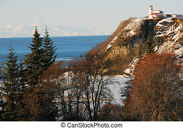 Landscape of a lighthouse on the coast of the Cook Inlet in Ninilchik, Alaska on the Kenai peninsula