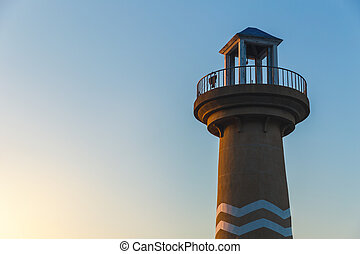 Lighthouse in sunset clear blue sky