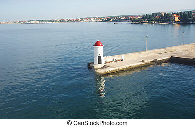 Lighthouse in the city harbor