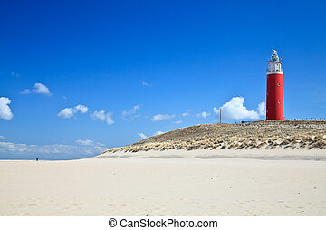 Lighthouse in the dunes at the beach