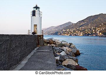 Lighthouse in the Village of Camogli near Genoa, Italy