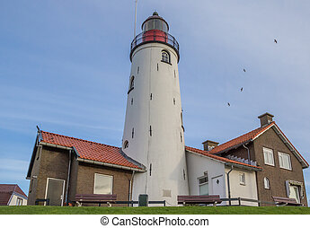 Lighthouse in Urk at the coast of the IJsselmeer