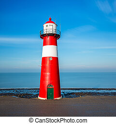 lighthouse in westkapelle a the sea