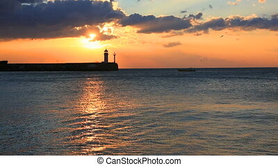 Lighthouse in Yalta at sunrise, Crimea - Colorful landscape...