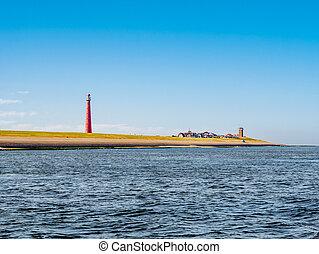 Lighthouse Lange Jaap at North Sea coast, Huisduinen, Den...