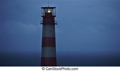 Lighthouse light spining around. Red and white lighthouse. -...