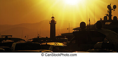 lighthouse - Lighthouse of saint tropez with ships in sunset