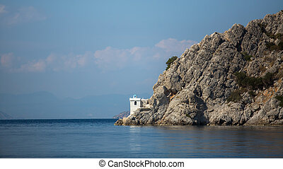 Lighthouse on a cliff in the sea