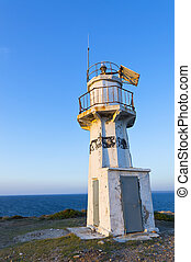 Lighthouse on background of blue clear sky