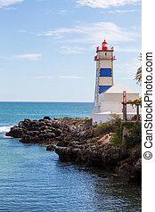 lighthouse on ocean coast in bay cascais