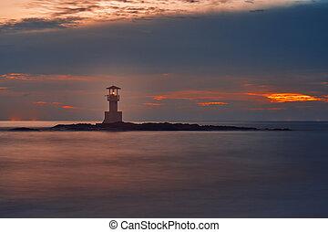 Lighthouse on the coast at sunset