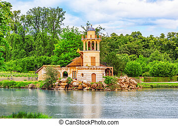 Lighthouse on the lake in  hamlet Queen Marie Antoinette's estate near Versailles Palace.