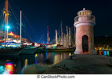 lighthouse on the pier at night in Marmaris
