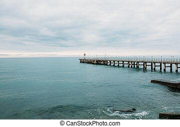 Lighthouse on the pier. Black Sea. Sochi