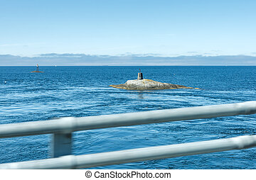 Lighthouse on the rock looking like submarine, Northern...