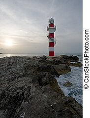 Lighthouse on the Rocks - Lighthouse in the tropics on a ...