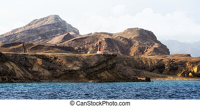 lighthouse on the rocky shore of the Red Sea in Egypt