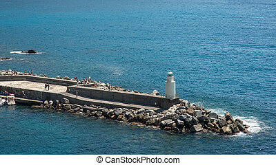 lighthouse over the sea in Camogli, Italy
