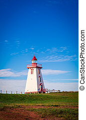 lighthouse prince edward island - Lighthouse on a hill in...