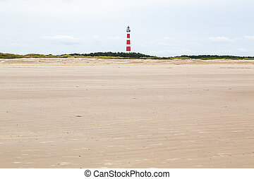 Lighthouse seen from the beach on an island in the North Sea, Ameland, Holland