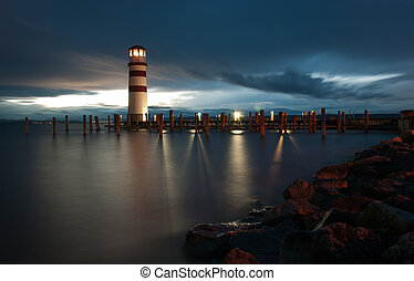 Lighthouse at Lake Neusiedl at cloudy night