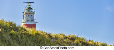 Banner close up view of Lighthouse at Waddenisland Texel, North Holland, Netherlands