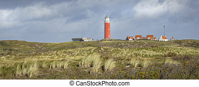 Panorama with scenic view of Lighthouse and rainy clouds at Waddenisland Texel, North Holland, Netherlands