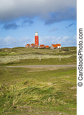 Vertical landscape with scenic view of Lighthouse and rainy clouds at Waddenisland Texel, North Holland, Netherlands