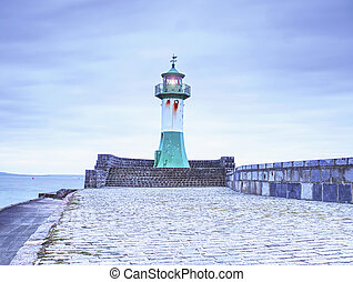 Lighthouse tower on stony mole in Sasssnitz