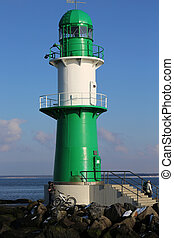 the lighthouse of the entrance of the Rostock Port in Warnemuende, Germany