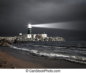 Lighthouse with a beam of light - Image of a lighthouse with...