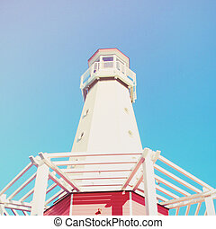 Lighthouse with blue sky, retro filter effect