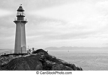 Black and White Photo of Ocean shore with Classic Lighthouse