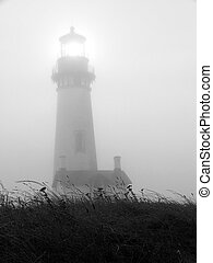 Lighthouse - Yaquina Head lighthouse shines brightly on a...
