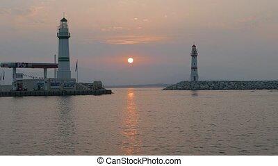 Lighthouses of the marina entrance at the sunrise. 4k