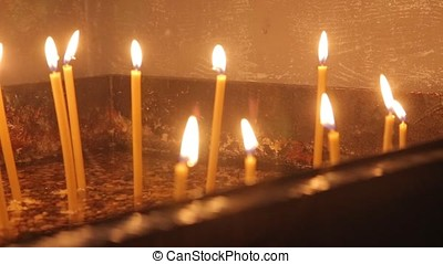 Lighting A Candle With A Match To Get A Romantic Candlelight. Amazing andles and candlesticks are on the table. Stay lights with the peaceful background of religious ceremony.