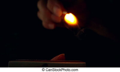 Lighting a match in slow motion .