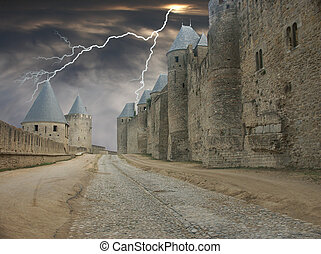 Lighting Alley - Carcasonne Castle in France with a stormy...