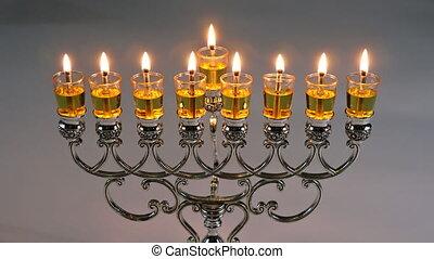 Lighting candles in menorah for Hanukkah