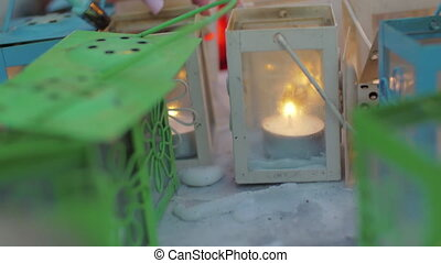 Lighting candles in street lanterns - Close-up shot of a...