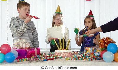 Lighting candles on the birthday cake